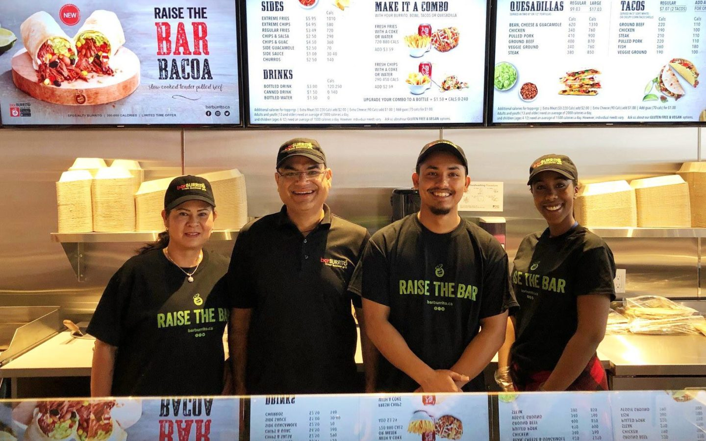 four employees of bar burrito location