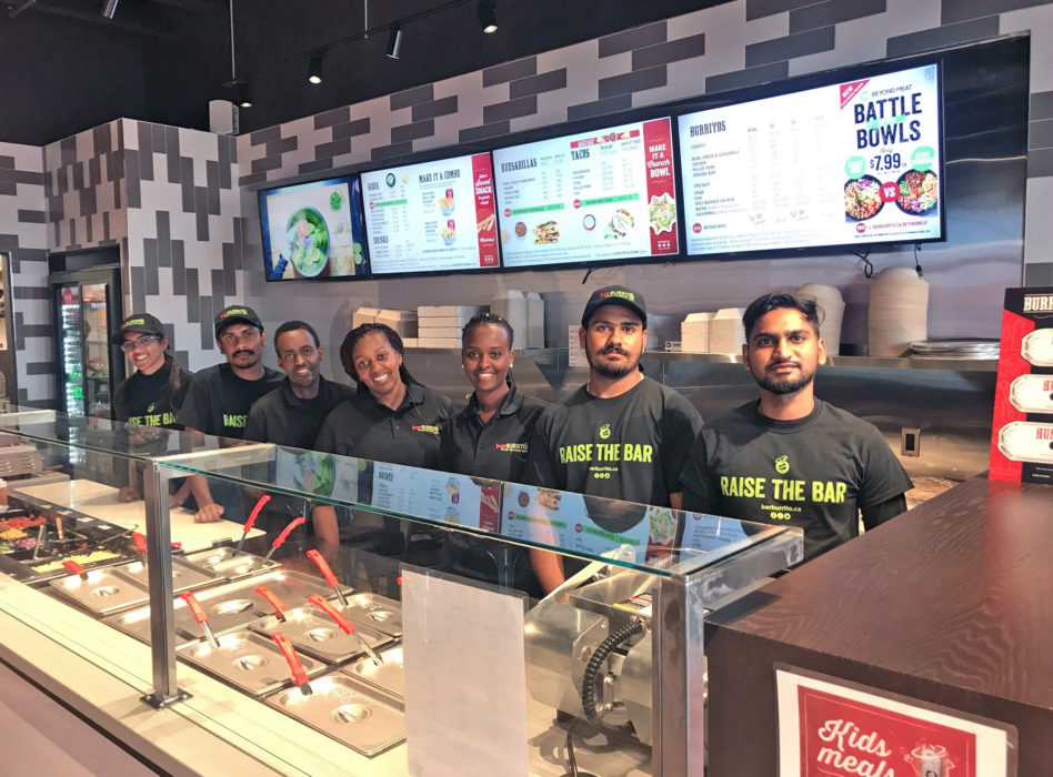 group of employees behind counter