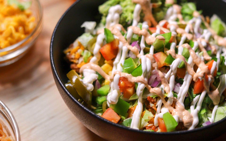 vegetable salad on black bowl