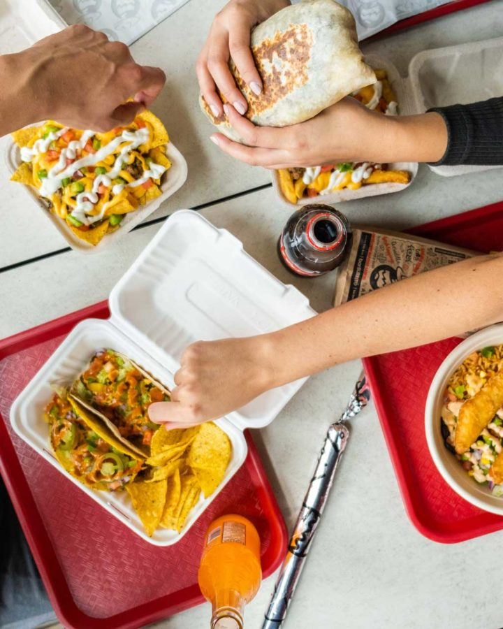 overhead photo of people eating Mexican food