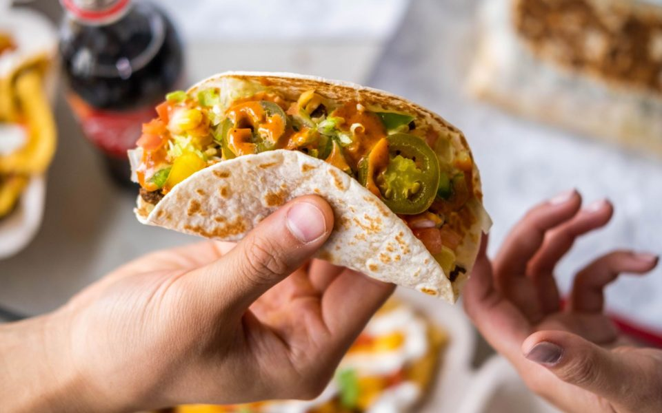 person holding a taco